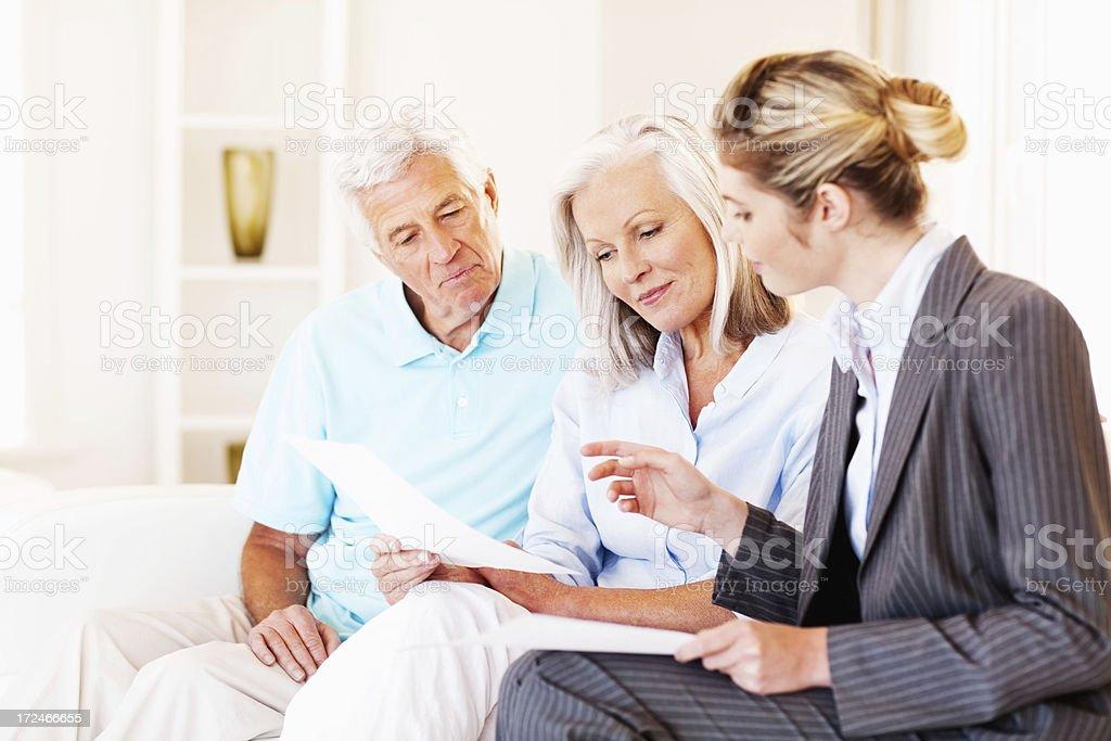 Advisor Explaining Investment Scheme To Senior Couple royalty-free stock photo