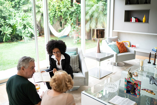 istock Advisor showing and discussing some data with her clients 1146756557