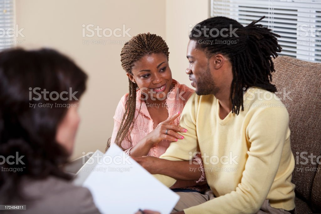 Advisor with African American couple royalty-free stock photo