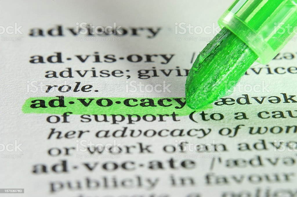 advocacy definition highligted in dictionary stock photo