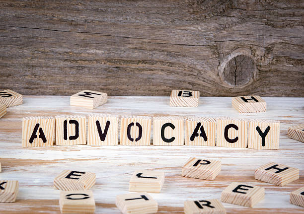 advocacy from wooden letters - help single word stock photos and pictures