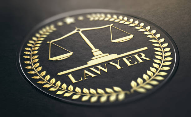 advocacy or lawyer gold symbol over black background - badge logo stock photos and pictures