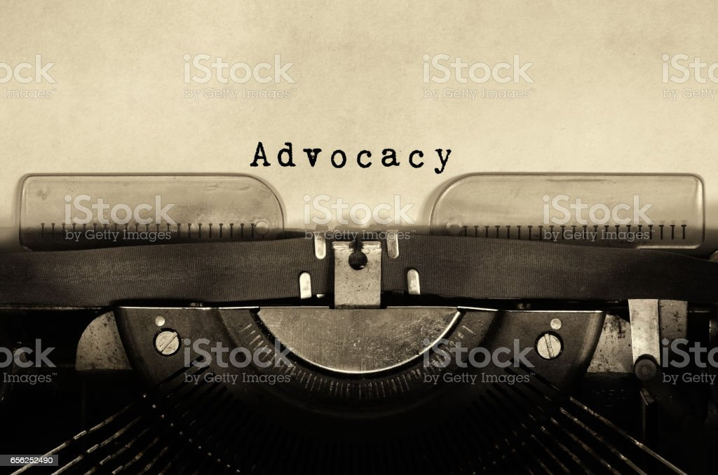 Advocacy word typed on vintage typewriter - foto de acervo