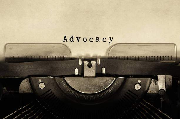 advocacy word typed on vintage typewriter - help single word stock photos and pictures