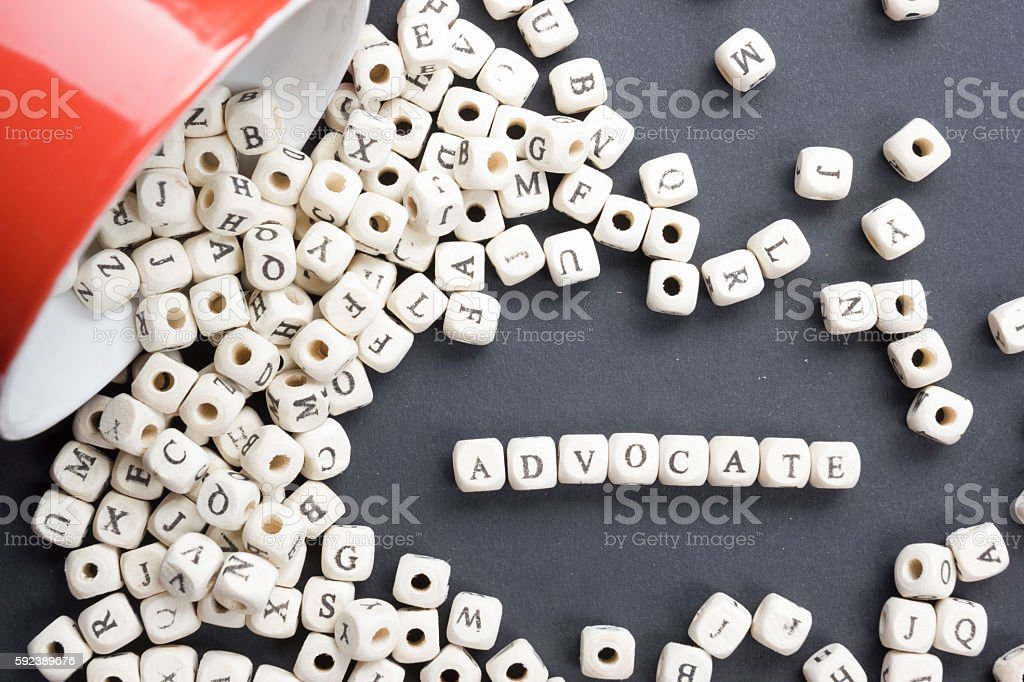 Advocate word written on wood block. Wooden ABc stock photo