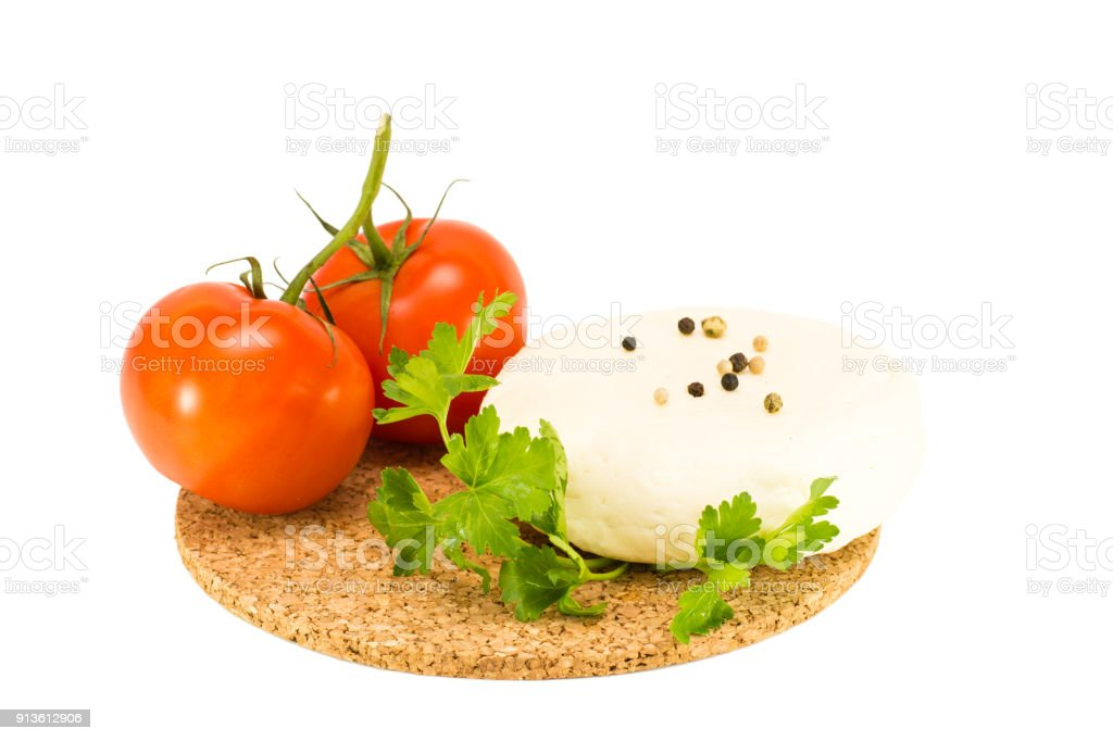 Adyghe cheese, parsley and tomatoes stock photo