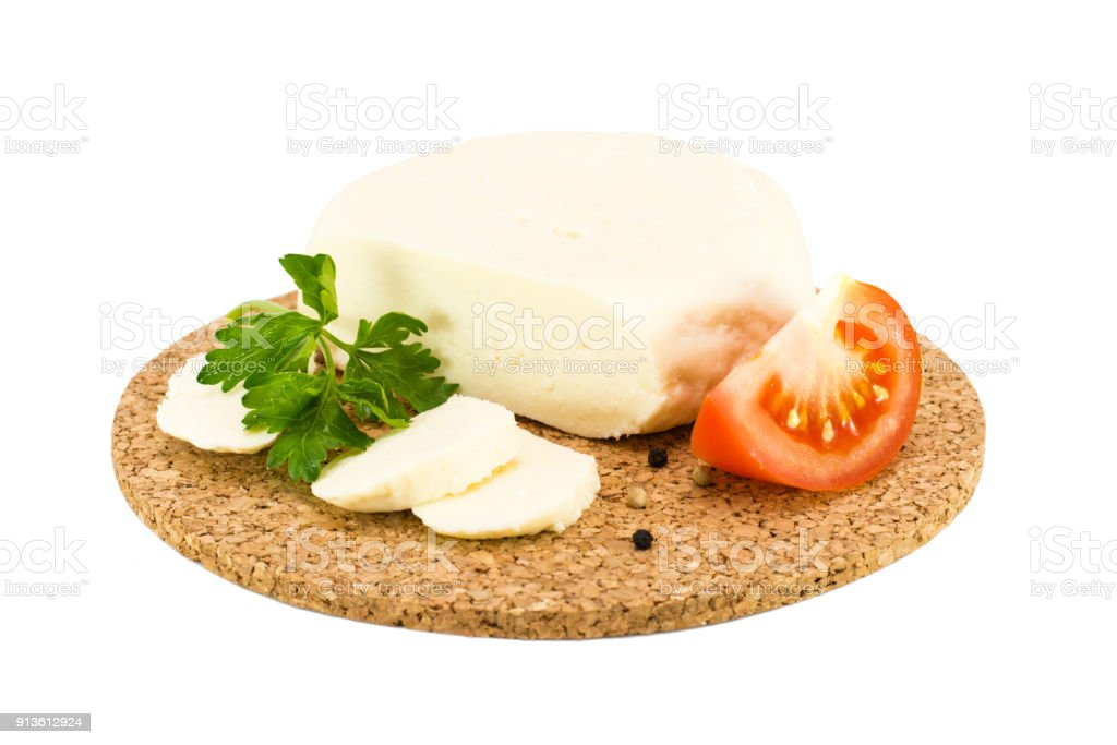 Adyghe cheese, tomato and parsley on a substrate on stock photo