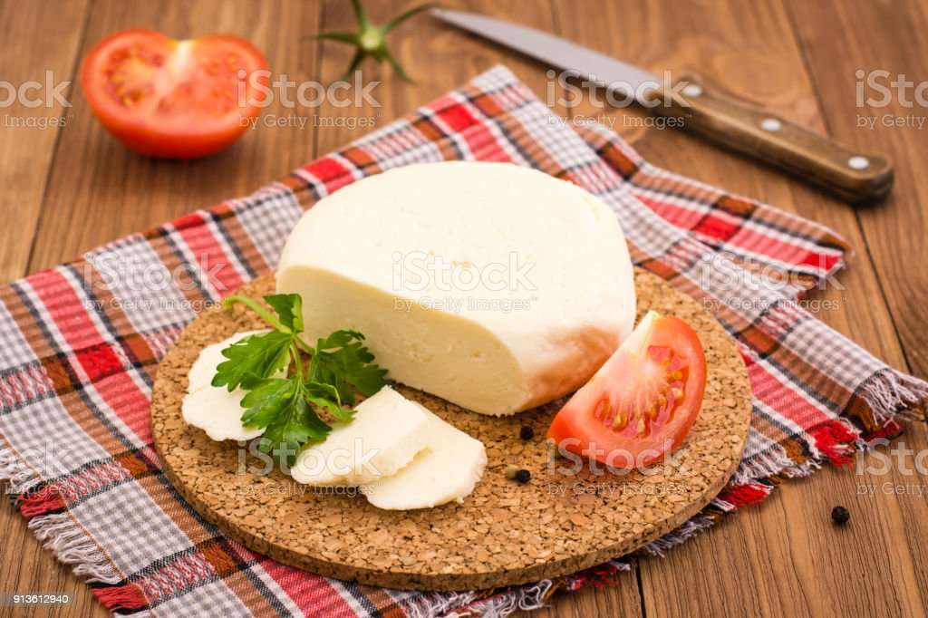 Adyghe cheese, tomato and parsley on a substrate stock photo