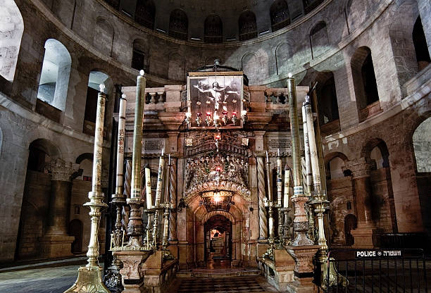 Aedicula in the Church of Holy Sepulchre Jerusalem, Israel - October 28, 2013: Aedicula in the Church of Holy Sepulchre, place believed to be Christ's tomb. Aedicula is encircled by so called Rotunda. religious saint stock pictures, royalty-free photos & images