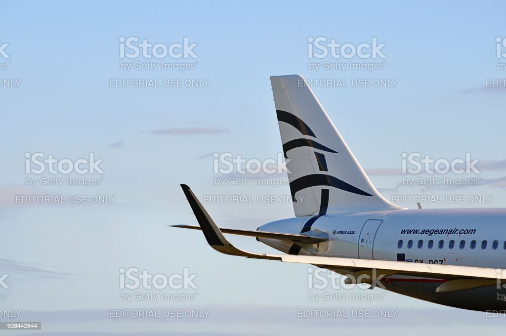 Aegean Airlines Airbus A320 tail and logo closeup in mid air. stock photo