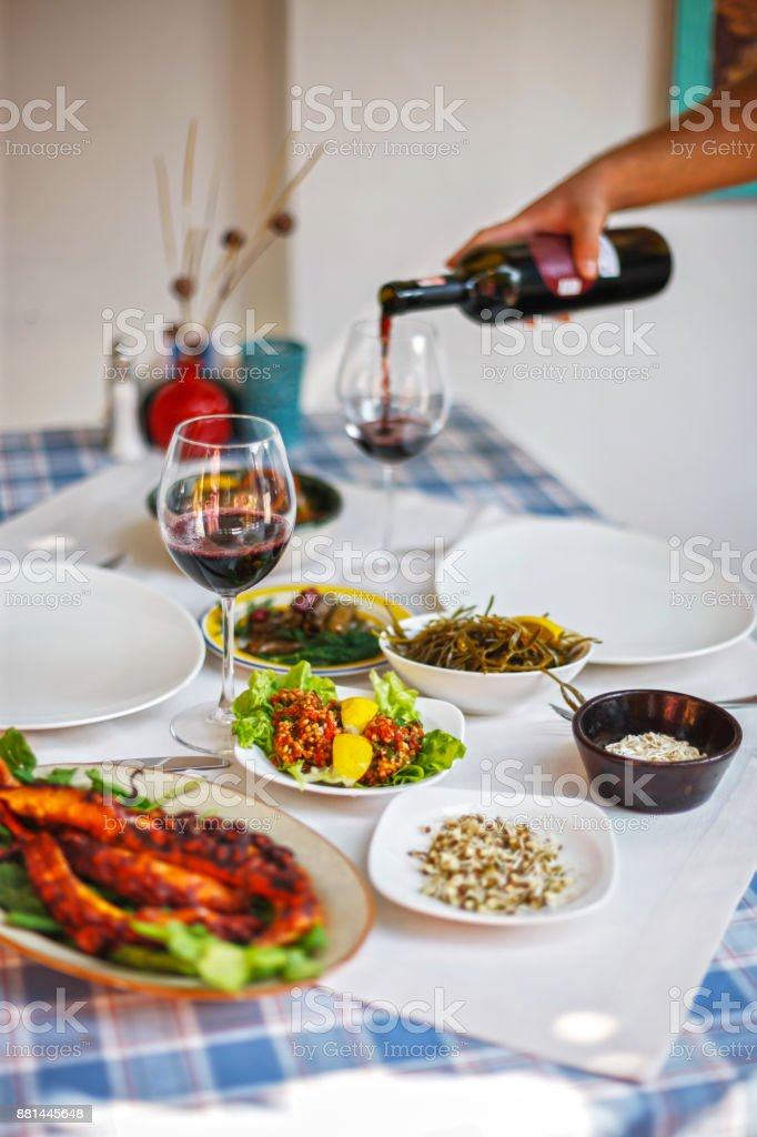 Aegean Appetizers Served with Red Wine stock photo