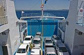 Canakkale, Turkey - July 1, 2019: Turkish island on Aegean sea called gökçeada (imroz), people in ferry boat to reach island from kabatepe on the aegean sea in a sunny day in Gokceada.