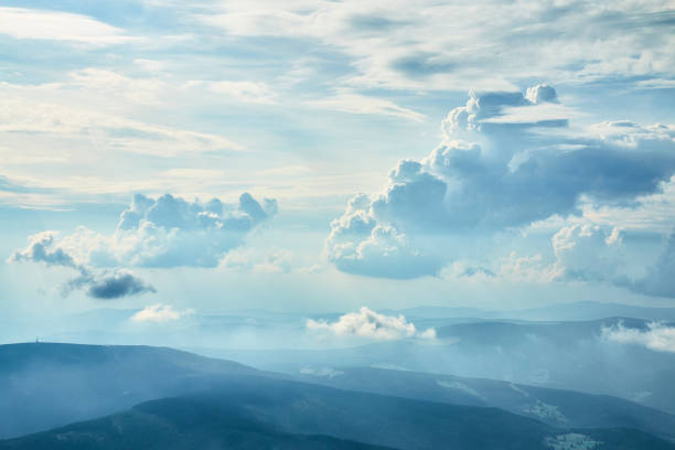 Aeial photo of beautiful clouds in blue sky with silhouettes of hills stock photo