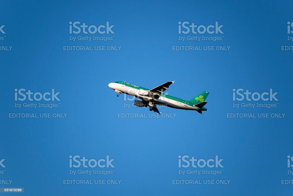 Aer Lingus Airplane on blue sky stock photo