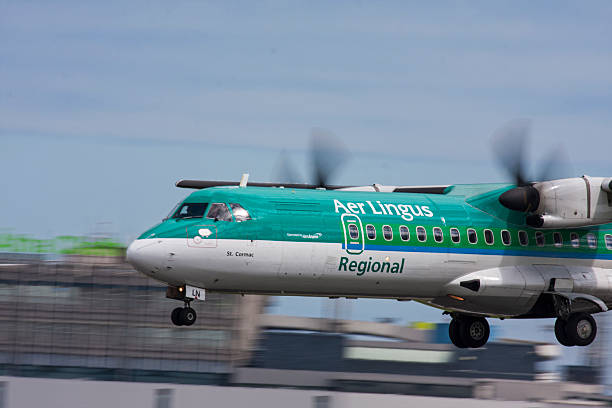 Aer Lingus Regional ATR72 Saint Cormac landing at Dublin Airport stock photo