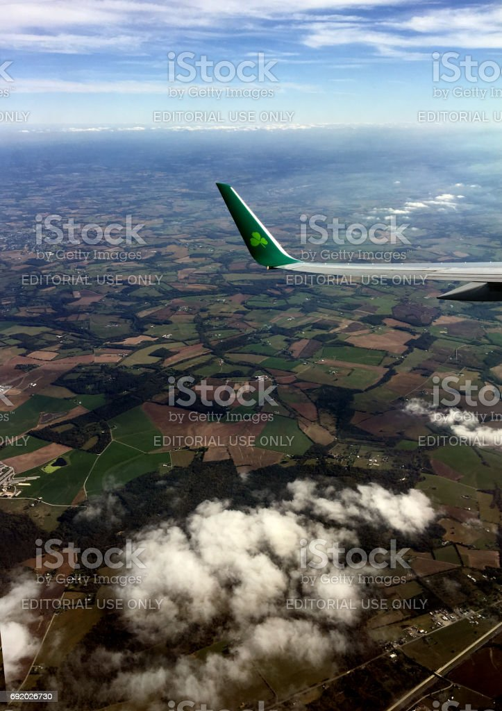 Aer Lingus wing tip over Ireland stock photo