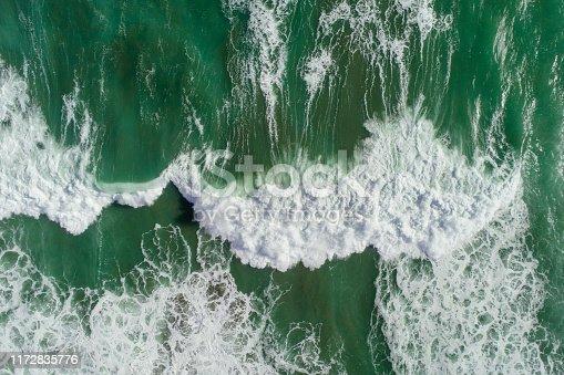 Aerial view of sea waves splashing.
