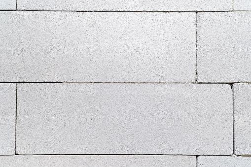 istock aerated concrete block background 1135977610