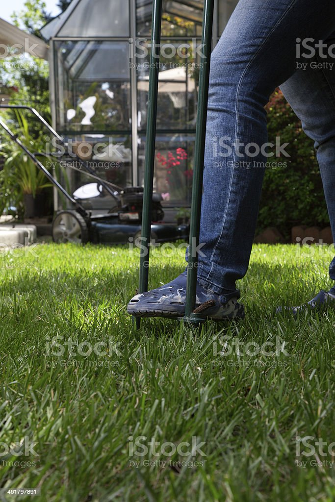 Aerating lawn stock photo