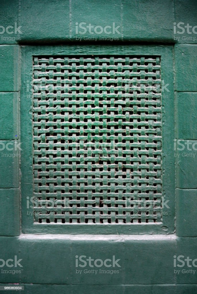 aeration grid on green wall stock photo