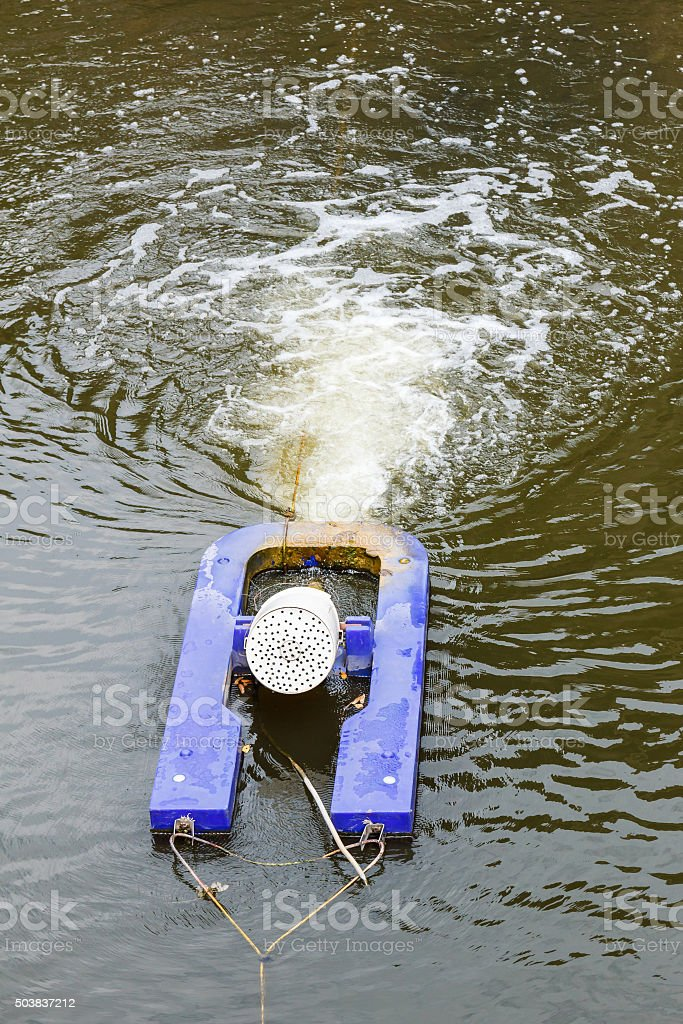 Aeration machine working in water. stock photo