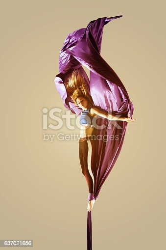 629965740 istock photo Aerial acrobatics acrobat girl isolated 637021656