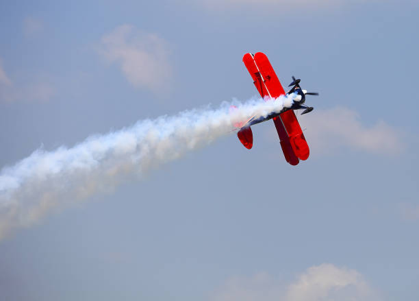 aerial acrobatics stunt flying - airshow stock photos and pictures