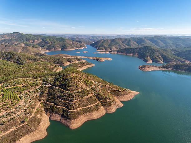 aerial. aero panorama dam in monchique odelouca. - fotos de barragem portugal imagens e fotografias de stock