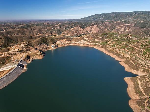 aerial. aerophotographing dam in monchique odelouca. - fotos de barragem portugal imagens e fotografias de stock