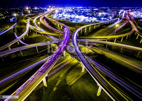 istock Aerial Austin Ambulance Interstate Interchange Expansive Night TimeLapse 506661296
