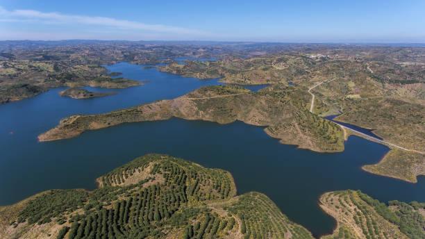 aerial. barrage of odeleite. flying a drone over the lake. - barragem portugal imagens e fotografias de stock