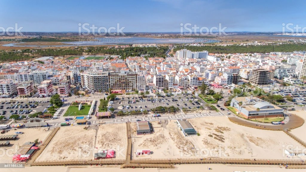 Aerial. Beaches and houses tourist city Monte Gordo view from sky stock photo