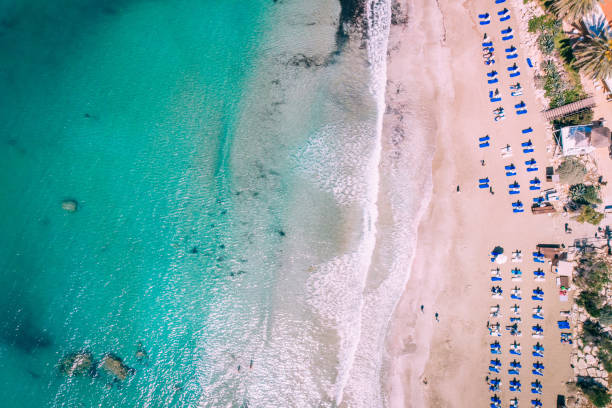 Aerial beautiful beach with crystal clear water, Coral Bay, Cyprus stock photo