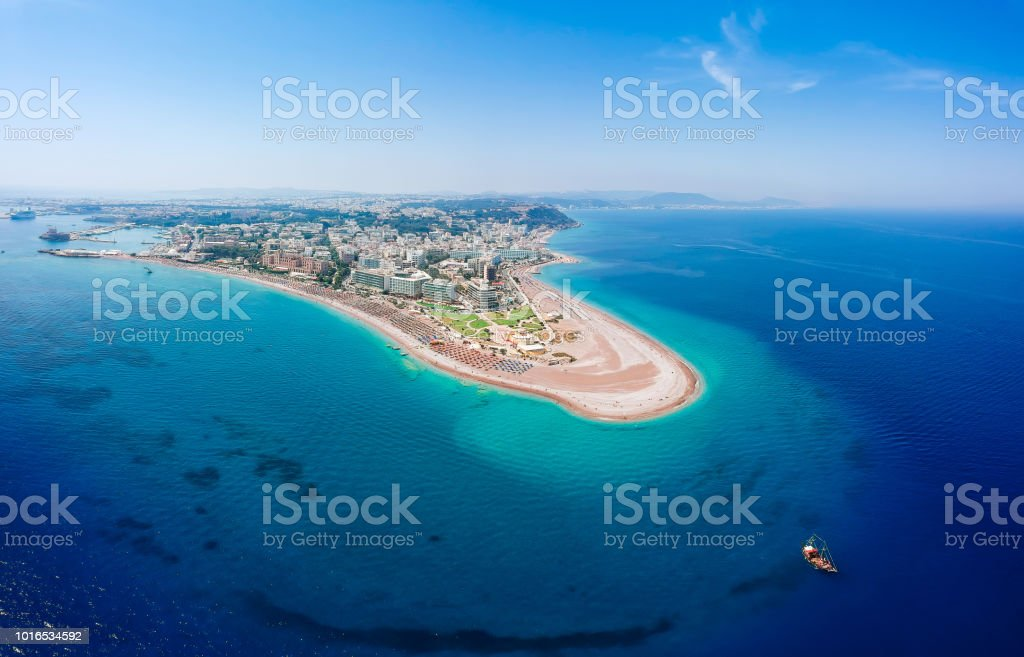 Aerial birds eye view drone photo of Elli beach on Rhodes city island, Dodecanese, Greece. Panorama with nice sand, lagoon and clear blue water. Famous tourist destination in South Europe stock photo