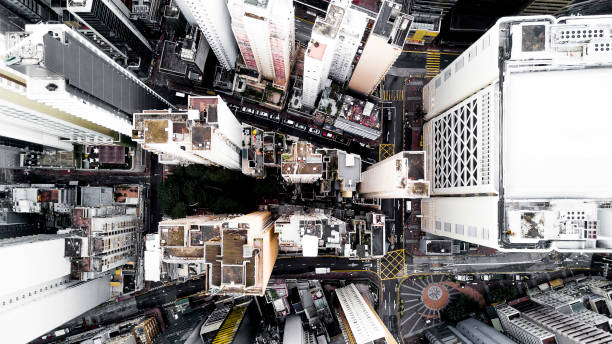 Aerial city view with crossroads and roads, houses, buildings and parking lots. Helicopter drone shot. Wide Panoramic image of Hong Kong. stock photo