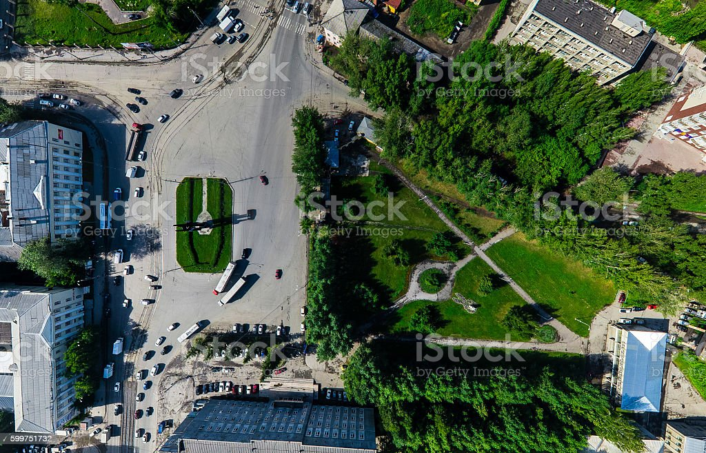 Aerial city view with crossroads and roads, houses buildings. Copter stock photo