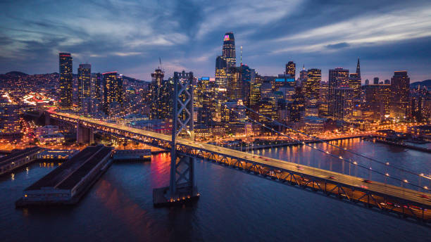 Aerial Cityscape view of San Francisco and the Bay Bridge at Night stock photo