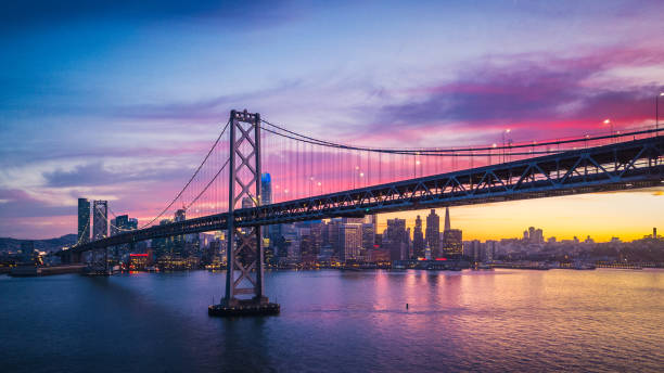 Aerial Cityscape view of San Francisco and the Bay Bridge with Colorful Sunset, California, USA Aerial Cityscape view of San Francisco and the Bay Bridge with Colorful Sunset, California, USA san francisco california stock pictures, royalty-free photos & images