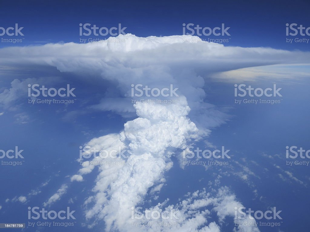 Aerial cloudscape of thunderstorm clouds on blue sky background. royalty-free stock photo