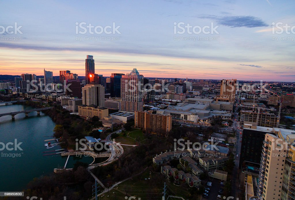 Aerial: Colorful Tranquil Sunset over Austin Texas Cityscape Skyline stock photo