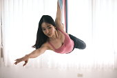 Aerial dancer performance with silks.