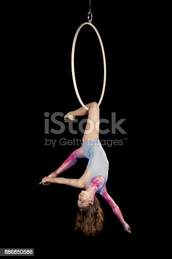 istock Aerial dancer performance with ring 886850586