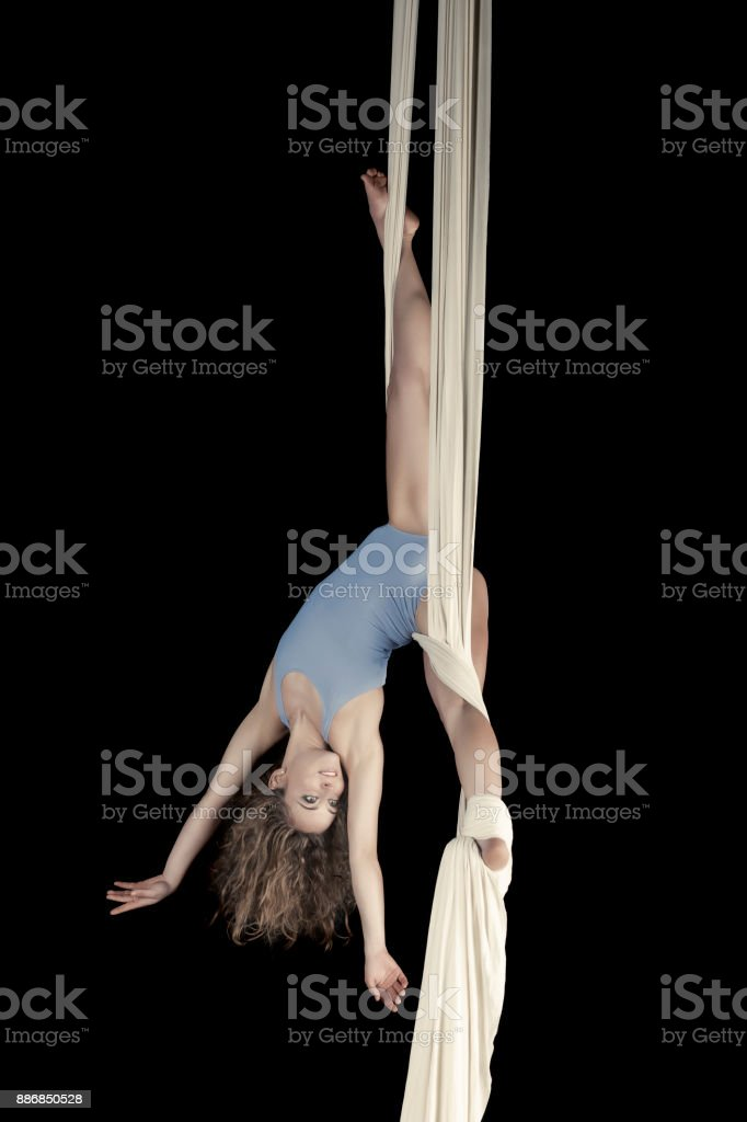 Aerial dancer performance with silks stock photo