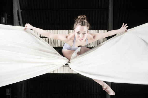 aerial dancer performance with silks - equilibrista foto e immagini stock