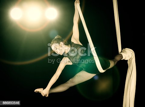istock Aerial dancer performance with silks 886850546