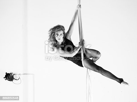 istock Aerial dancer performance with silks 886850548