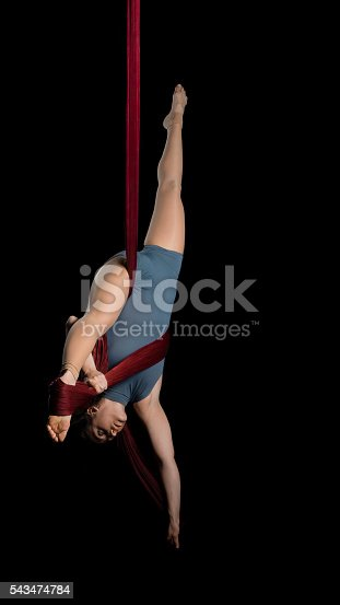629965740 istock photo Aerial dancer woman isolated on black 543474784