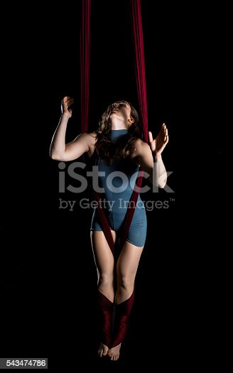 629965740 istock photo Aerial dancer woman isolated on black 543474786