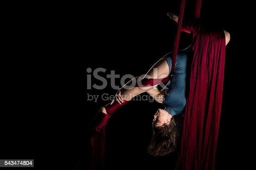 629965740 istock photo Aerial dancer woman isolated on black 543474804