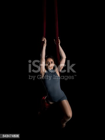 629965740 istock photo Aerial dancer woman isolated on black 543474806